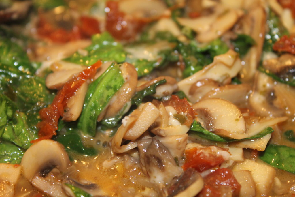White wine mushroom sauce with sun dried tomatoes and spinach.